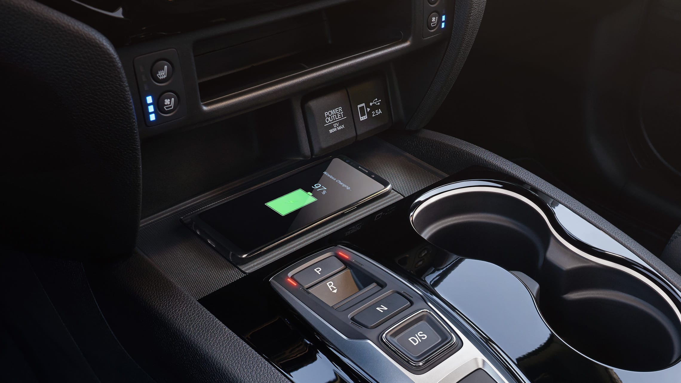 Wireless phone charger detail on the 2019 Honda Passport Elite.