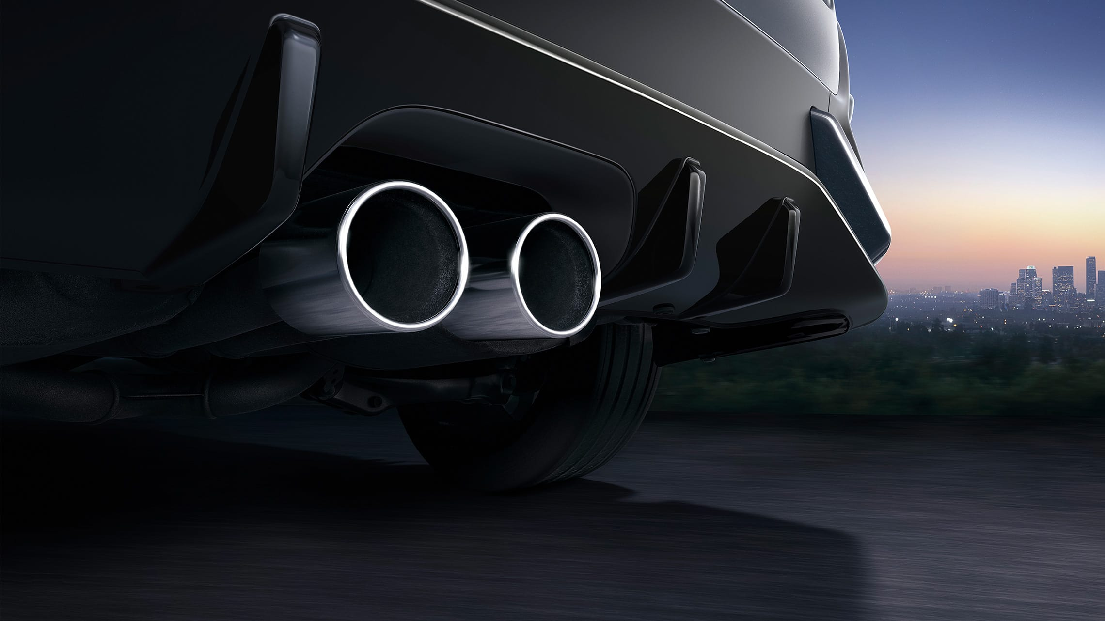 Center-mounted dual-outlet exhaust detail on the 2020 Honda Civic Sport Touring Hatchback in Sonic Gray Pearl.